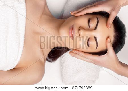 Face Massage.  Close-up Of Young Woman Getting Spa Massage Treatment At Beauty Spa Salon.spa Skin An