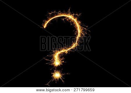 Question Mark Of Fireworks Close Up. Burning Sparkler Question Mark Isolated On Black Background. Si
