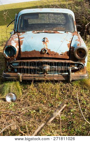 Old, Rusty Car Wreck Front And Lamp, Outdoor.