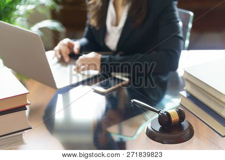 Judge Gavel And Lawyer Working On A Laptop In Office