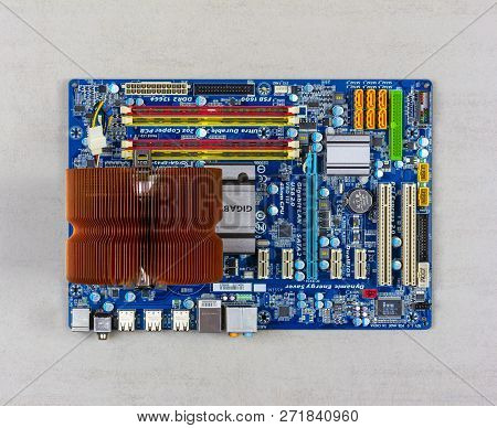 Maykop, Russia - November 17, 2018: Processor Cooling System And Ram On Gigabit Motherboard On Grey