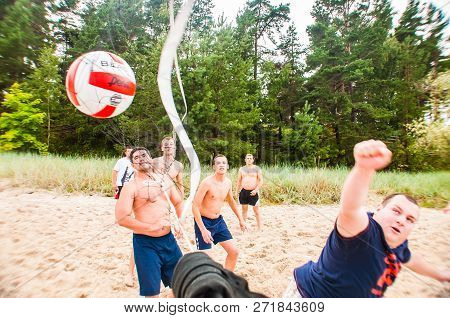 Jurmala, Latvia - August 20, 2011: Volleyball Ball Gets Into The Net. Beach Volleyball Game During T