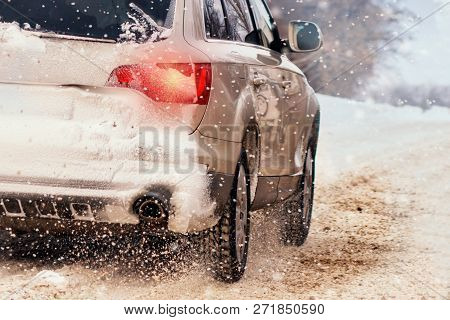 Dark Silver Car On Winter Road With Snow And Frost