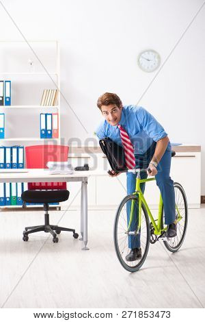 Young businessman using bike to commute to the office