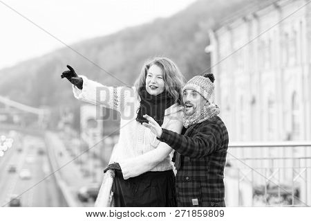 Aged Couple Happy Standing On Bridge. Woman And Man Point To Other Side. Couple Of Tourists Showing
