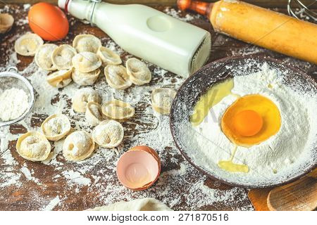Ingredients And Tools For Baking - Flour, Eggs And Glass Of Milk And Raw Homemade Delicious Traditio