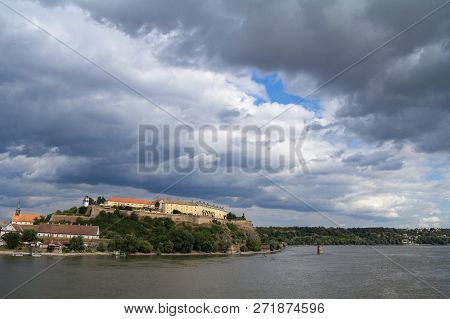 Petrovaradin Fortress In Novi Sad, Serbia, On Danube River, On A Cloudy Summer Afternoon. It Is One