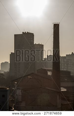 Old Brick Chimney From An Abandoned Factory, From The Industrial Revolution, While An Socialist Yugo