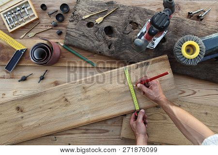 Hands Carpenter Work The Wood, Measuring With Tape Meter And Pencil Old Rustic Wooden Boards, Top Vi