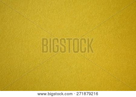 Gold or Yellow Colored Construction Paper. Close up view of Colored Construction Paper. Backgrounds and Textures. Opacity filter used to lighten and grade the image.