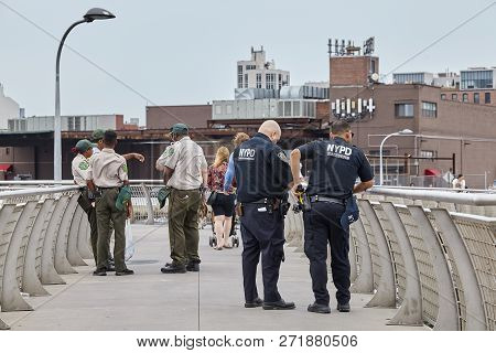 New York, Usa - July 04, 2018: The Nypd And Nyc Department Of Parks & Recreation Personnel Secure Th