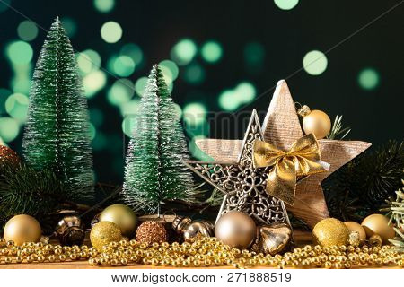 A Christmas decoration wooden star with fir trees