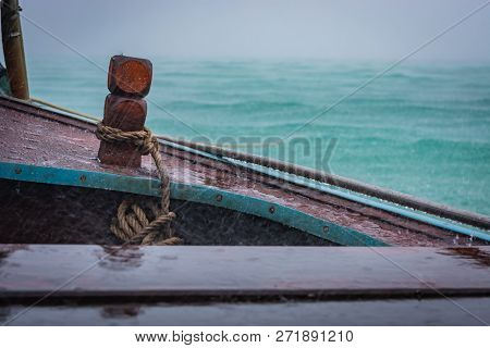 Wooden Boat In The Rain, Water In The Background, Thailand