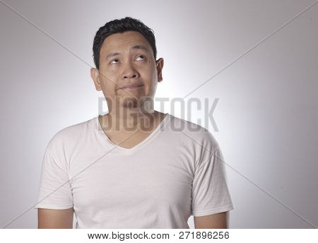 Portrait of funny young asian man bored with eyes glance up, Saturated, Bored guy, Tired man poster