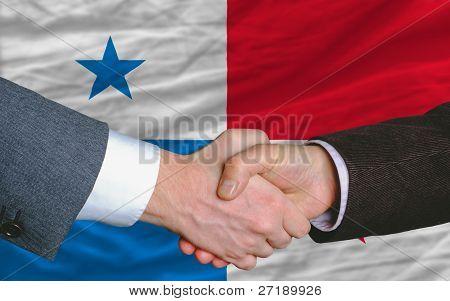 Businessmen Handshake After Good Deal In Front Of Panama Flag