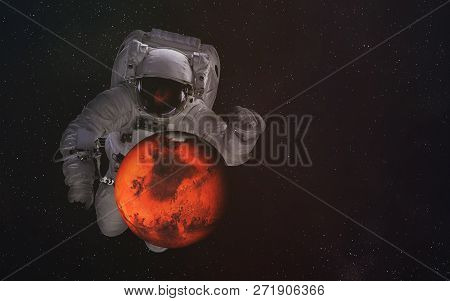 Single Giant Astronaut In Outer Space With Mars Planet Of Solar System With Reflection In Helmet. Sc