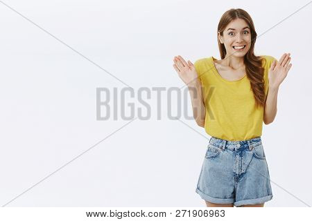 I Am Innocent Do Not Look At Me. Charming Clueless Charismatic Woman With Cute Braid In Yellow T-shi