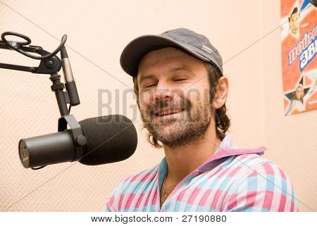 "BARNAUL, RUSSIA - SEPTEMBER 27: Svyatoslav Vacarchuk vocal of known ukrainian group ""Ocean Elzy"" gives interview on the radio ""Europa plus"" of their new album on September 27, 2010 in Barnaul, Russia."