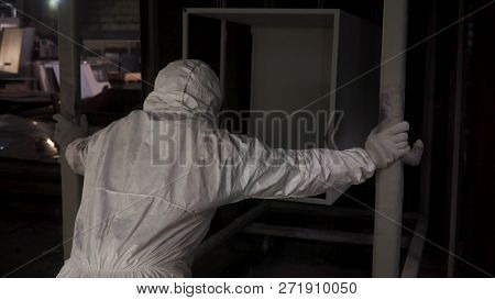 Worker Puts A New Object In The Paint Booth For Painting. Clip. Painting Booth At The Factory. Trade