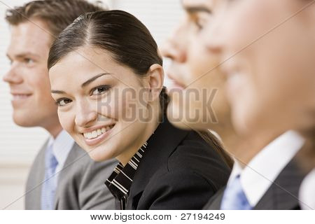 Businesswoman posing with colleagues