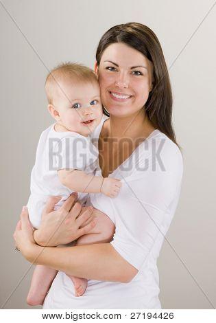 Studio shot of loving mother holding baby