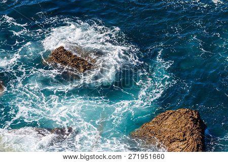 Sea Waves Breaking On A Rocks. Deep Blue Sea Waves Hit Cliff, Hit Rocks Cliff. Mighty Sea Waves Brea