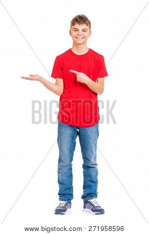 Full Length Portrait Of Teen Boy Holding Something Imaginary On Palm, Isolated On White Background.