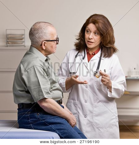 Patient listening to doctor explain how to take prescription medication