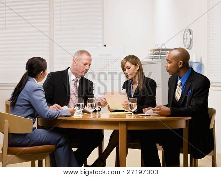 Co-workers having financial meeting in conference room