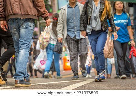 Hong Kong, China - December 6, 2016: Asian Families And Tourists Walking Through The Crowded Causewa