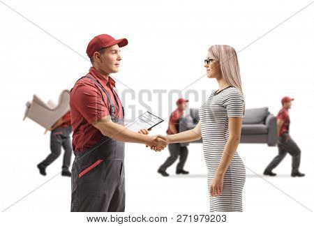 Mover shaking hands with a woman and movers carrying furniture in the back isolated on white background