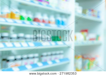 Blurred Picture Of Medicine Shelf In Drug Store. Pharmacy Shop Interiors. Pharmaceutical Products In