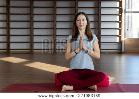 Young Woman In The Lotus Position While Meditating