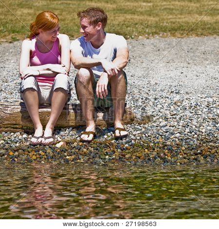 Couple sitting near stream