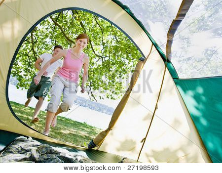 Couple running to tent