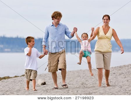 Family playing at beach