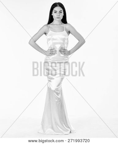 Woman In Elegant White Dress With Long Hair, White Background. Elegant Dress Concept. Fashion Model