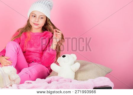 Kid Cute Girl Play With Soft Toy Teddy Bear Pink Background. Unique Attachments To Stuffed Animals.