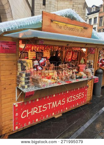 Brussels, Belgium - December 2, 2018: A Vendor Sells Artisan Chocolate And Biscuits For Christmas An