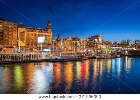Amsterdam City With Boats On Canal In Holland