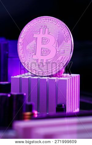 Image bitcoin and processor on pink background