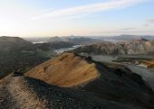 Panoramic view on popular most remote tourist destination Landmannalaugar geothemal area at sunset from the top of volcanic mountain Blahnukur, Highlands in south Iceland, Europe poster