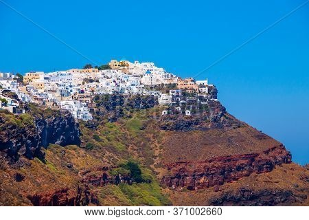 Traditional White Cave Houses On A Cliff On The Island Santorini, Cyclades, Greece