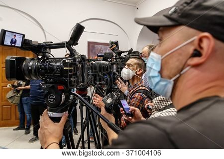 Mukachevo, Western Ukraine - June 11, 2020: Videographers In Protective Masks During The Working Vis