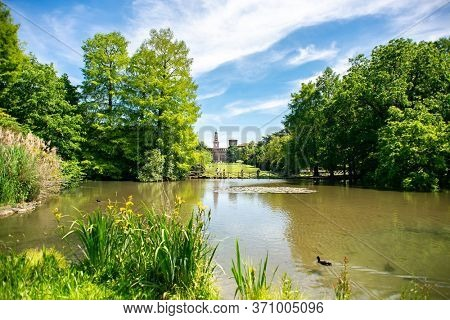 Milan. Italy - May 21, 2019: Pond in Sempione Park (Parco Sempione) in Milan, Italy. Sforza Castle (Castello Sforzesco) on Background.