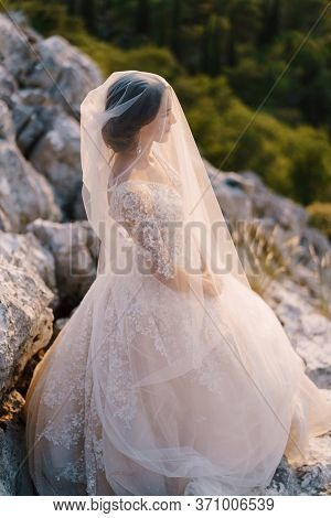 Close-up Portrait Of A Bride Covered With A Veil. Fine-art Destination Wedding Photo In Montenegro,