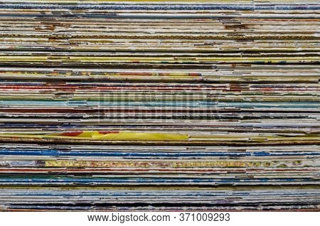 Texture Of Old Magazines And Comics. A Stack Of Shabby Old Magazines Background. Collection Of Rando