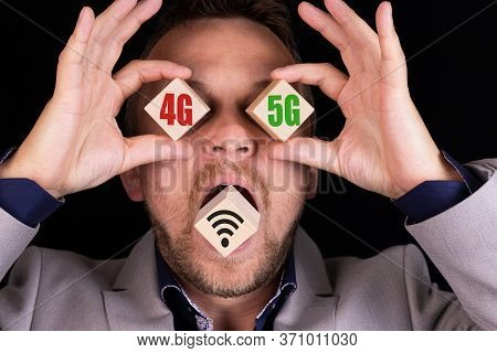 Business Concept Of Choosing And Comparing 4g And 5g Communication Standards. The Businessman Holds