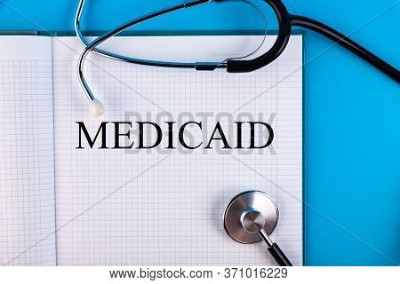 Medicaid Text Written In A Notebook Lying On A Desk And A Stethoscope. Medical Concept.