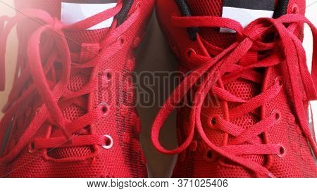 Fashion Shoes With Shoestring. Red Sneaker And Shoelace So Close.